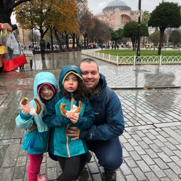 Enjoying a bretzel in the rain!